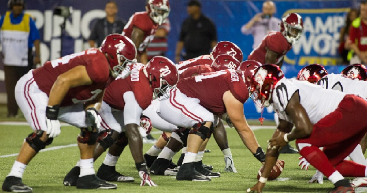 Alabama's offense lines up against Louisville on Sept. 1.