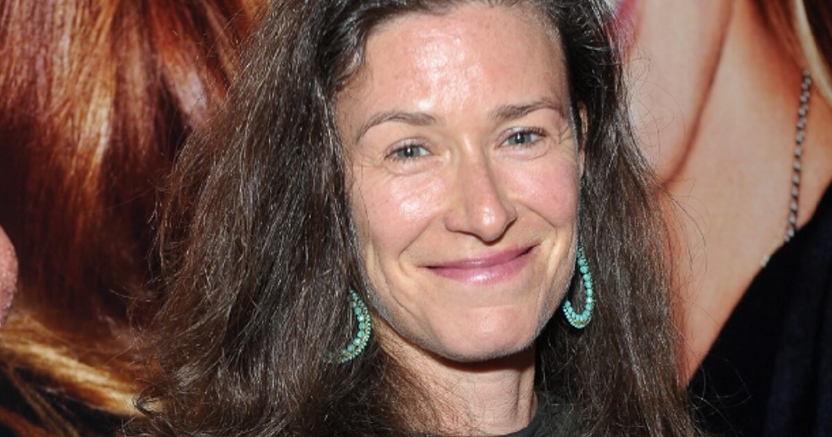 Amy Siskind smiling at the camera.