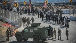 U.S. military personnel and Border Patrol agents beef up security at the San Ysidro border crossing near San Diego in a November file photo.