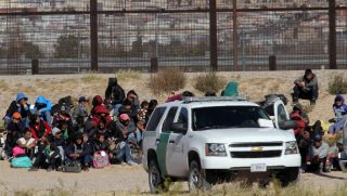 Border Patrol agents detain illegal aliens who crossed the southern border into the United States on Dec. 3.