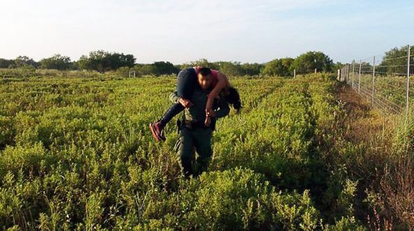 A Border Patrol agent from the Rio Grande Valley Sector rescues a Honduran woman who had been abandoned by a human smuggler on a local ranch.