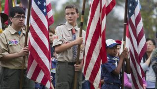 Boy Scouts holding flags.