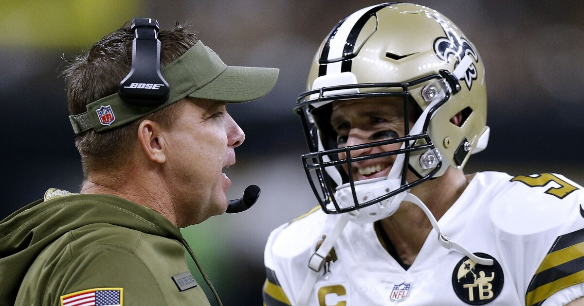 Quarterback Drew Brees and head coach Sean Payton of the New Orleans Saints talk during a Nov. 18 game against the Philadelphia Eagles at the Mercedes-Benz Superdome.