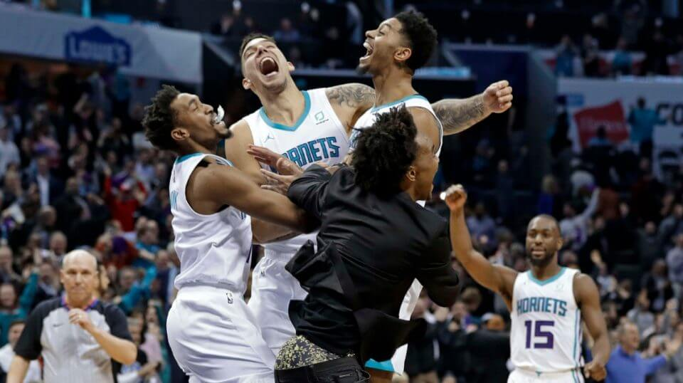 The Charlotte Hornets' Jeremy Lamb, jumping right, celebrates with teammates Malik Monk, left, Willy Hernangomez, center, and Devonte' Graham, front, as Kemba Walker (15) celebrates in background after Lamb's go-ahead and eventual game-winning basket against the Detroit Pistons on Wednesday in Charlotte.