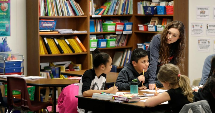 Chelsea Duvenez works with students in her fourth-grade classroom at Olympic View Elementary School on March 9, 2018, in Lacey, Washington.