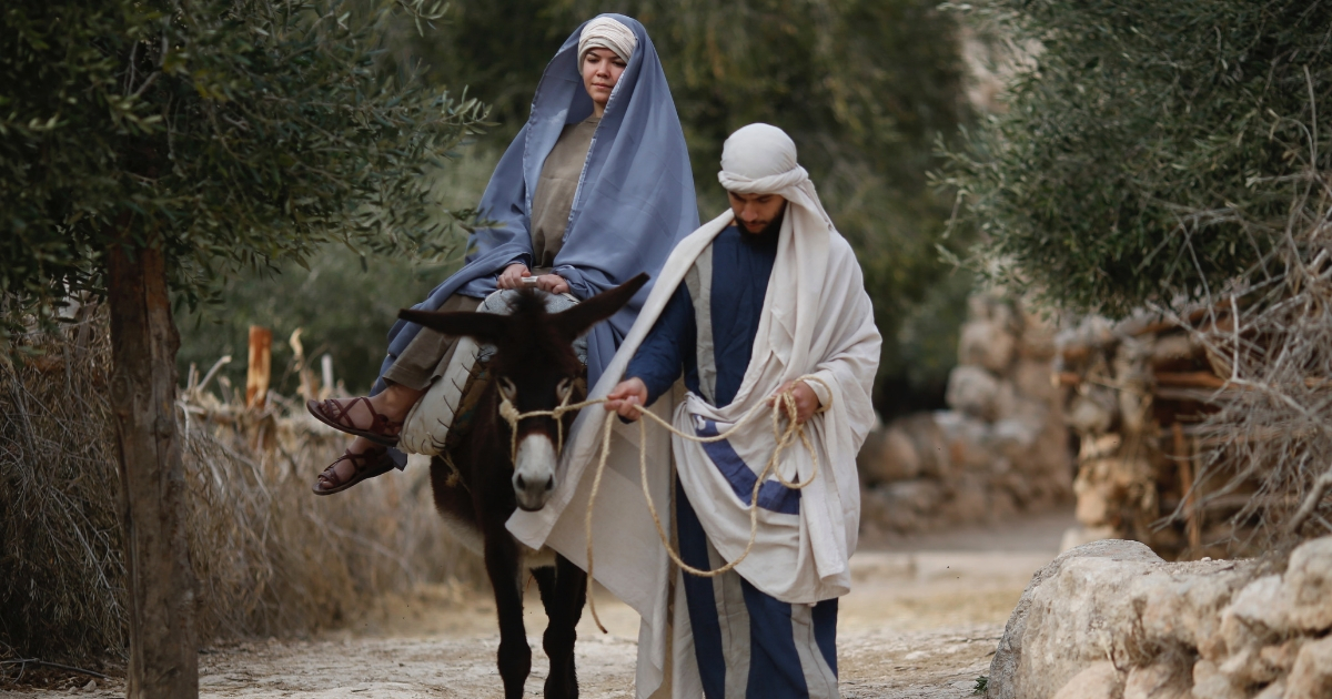 Christian actors portray Joseph and Mary during a re-enactment of a Nativity scene of the journey to Bethlehem as part of Christmas festivities at the Nazareth Village, northern Israel, Dec. 21, 2017.