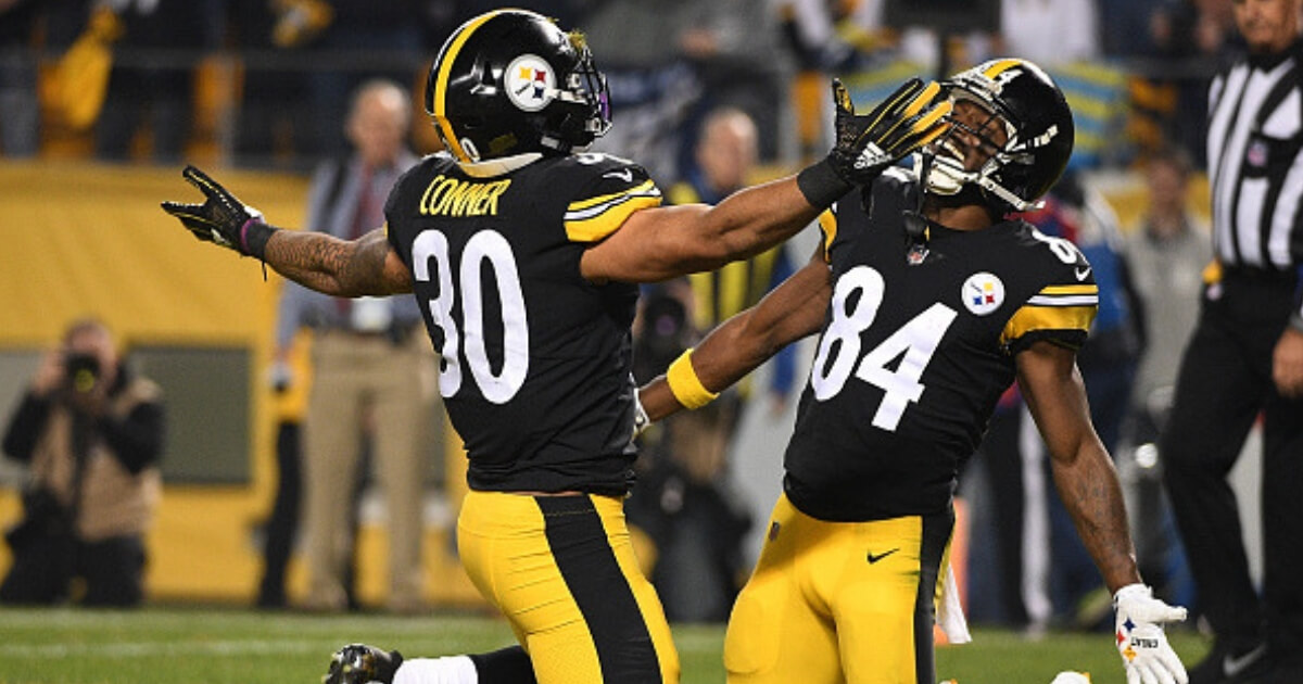 James Conner, left, and Antonio Brown of the Pittsburgh Steelers celebrate after a score in Sunday's game against the Chargers.