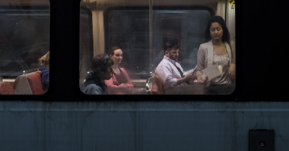 Commuters ride aboard the Metro in Washington, D.C.