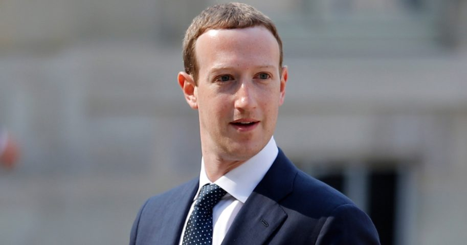 """Facebook's CEO Mark Zuckerberg, arrives to meet France's President Emmanuel Macron after the """"Tech for Good"""" Summit at the Elysee Palace in Paris on May 23, 2018."""