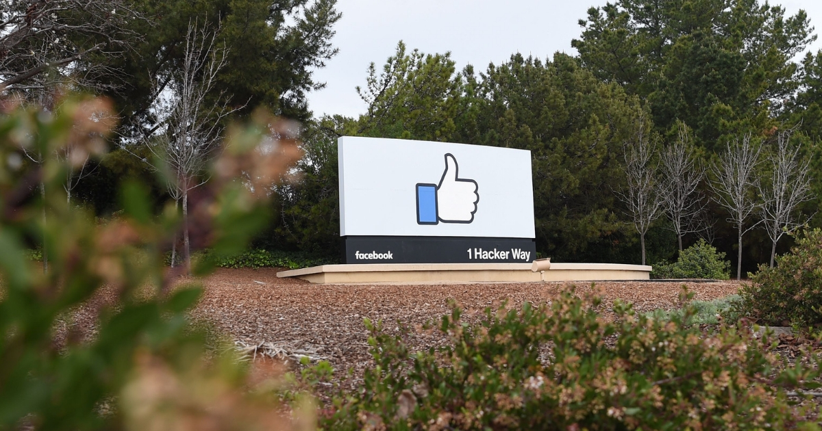 A sign is seen at the entrance to Facebook's corporate headquarters location in Menlo Park, California on March 21, 2018.