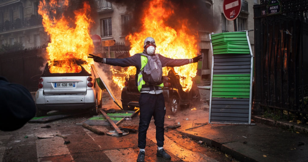 Protesters clash with riot police in Paris.