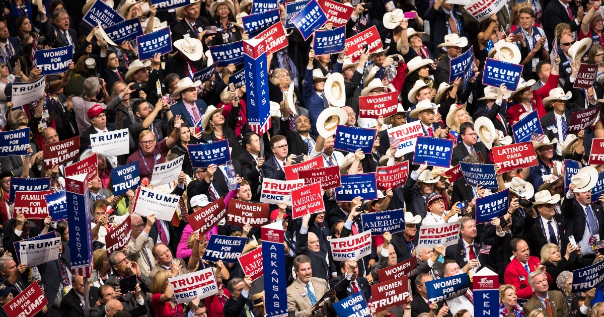 GOP delegates cheer as Donald Trump delivers his nomination acceptance speech on the final day of the Republican National Convention on July 21, 2016, at Quicken Loans Arena in Cleveland.