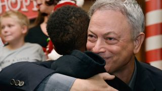 Actor Gary Sinise meets with Gold Star families at the Gary Sinise Foundation's Snowball Express Send-Off Celebration at LAX Airport on Saturday.