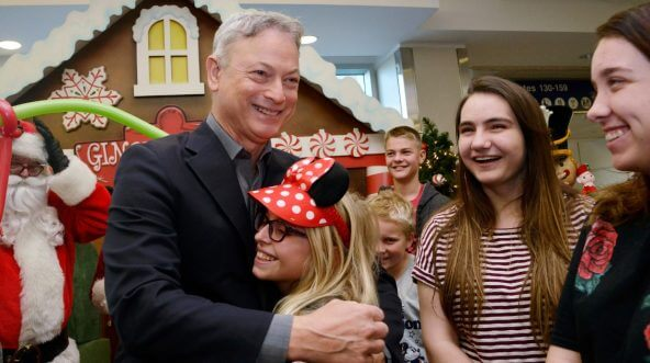 Actor/humanitarian Gary Sinise meets with Gold Star families at the Gary Sinise Foundation's Snowball Express Send-Off Celebration at LAX Airport on Dec. 8.