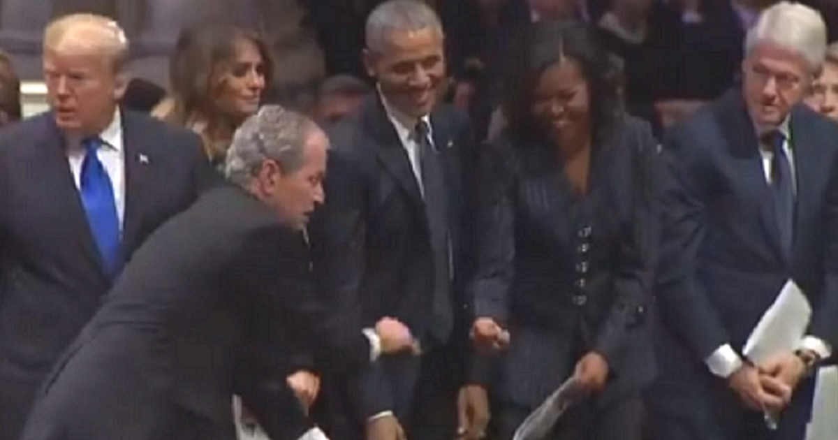 George W Bush Offers Lighthearted Gesture to Michelle Obama at His Father's Funeral