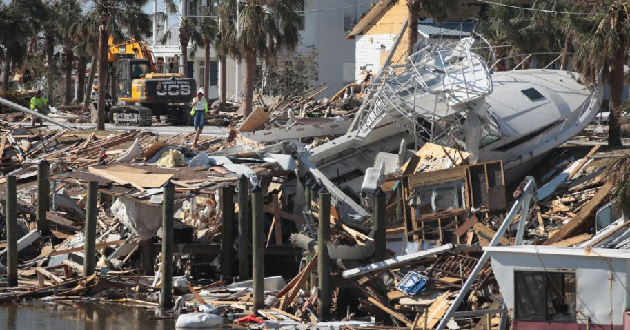 A boat washed ashore is among the damage from Hurricane Michael in Florida