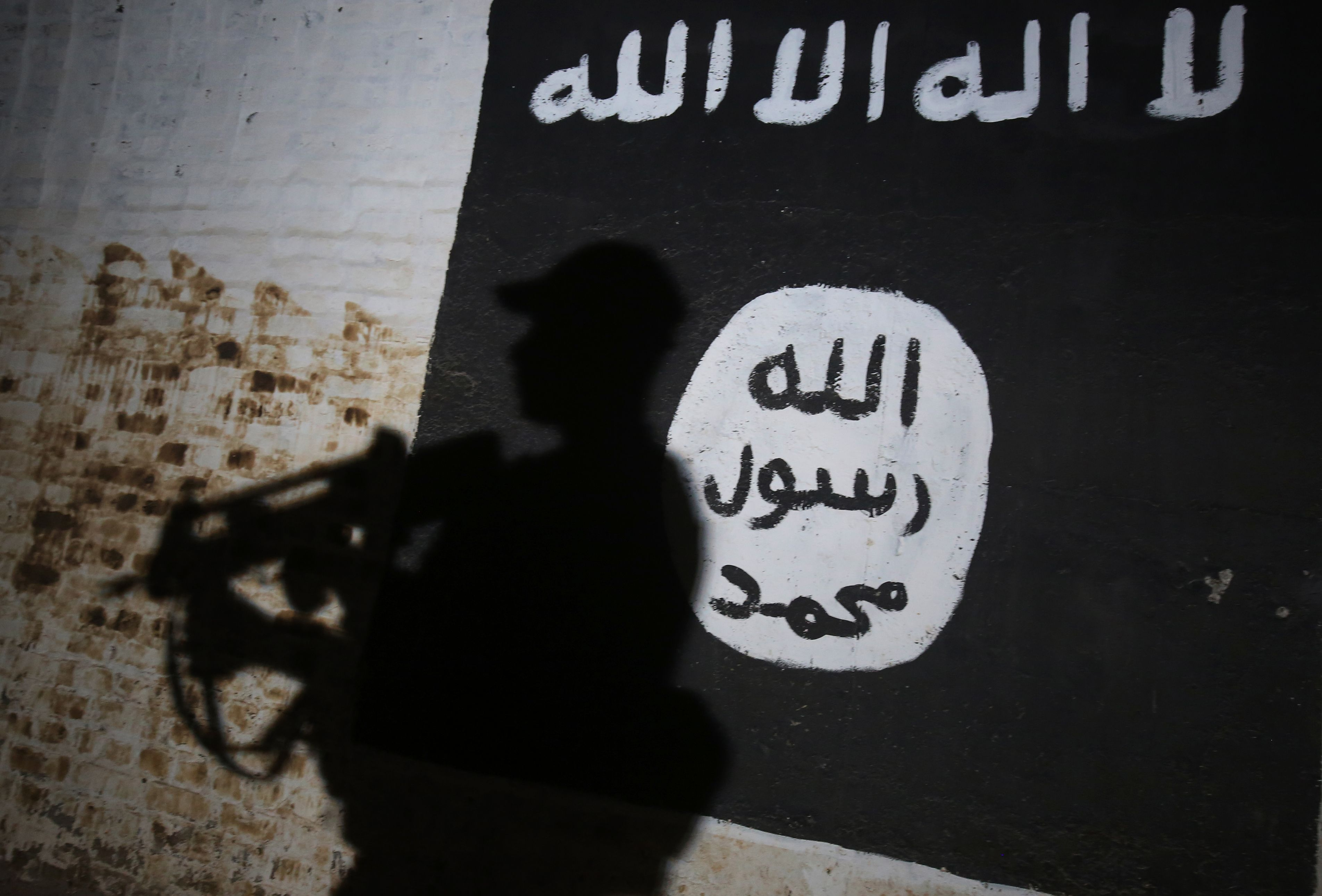a mural bearing the logo of the Islamic State
