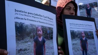 Central American migrants hold a demonstration Saturday in Tijuana, Mexico, over the death of 7-year old Jakelin Caal Maquin.