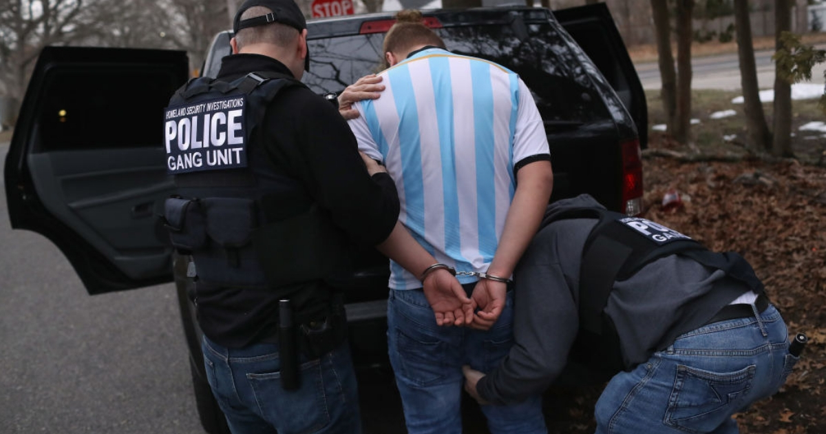 Immigration and Customs Enforcement officers arrest a man suspected of being an MS-13 gang member
