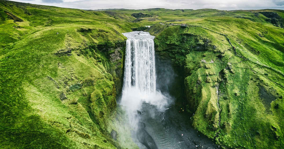 An aerial view of Skogafoss, a waterfall in southern Iceland, taken by drone.