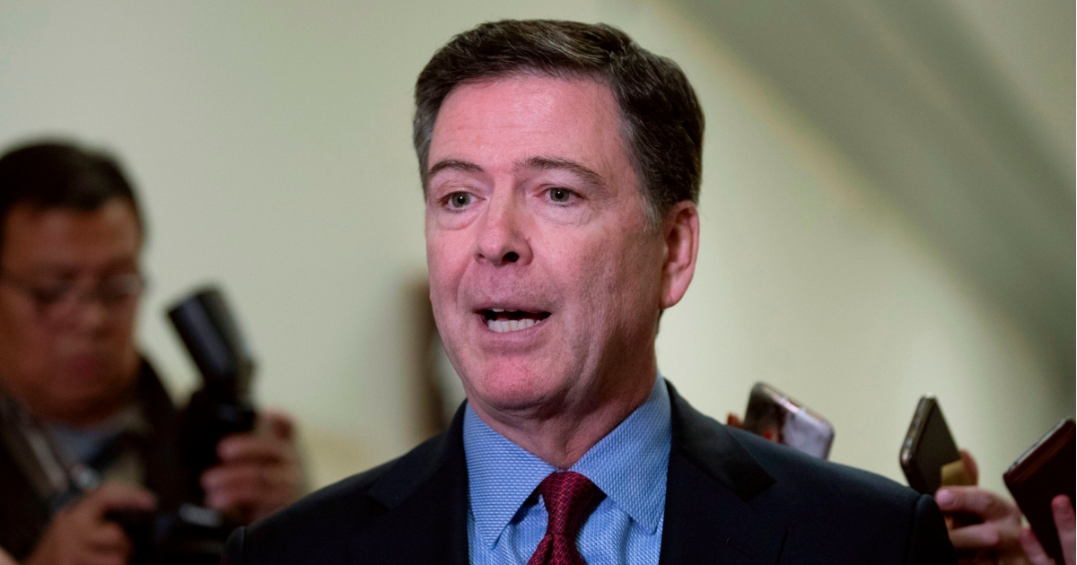 Former FBI Director James Comey talks to reporters Dec. 7 following a closed House Judiciary Committee meeting on Capitol Hill.