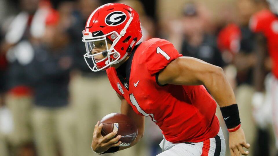 Justin Fields of the Georgia Bulldogs runs with the ball against the Alabama Crimson Tide during the SEC Championship Game on Dec. 1 at Mercedes-Benz Stadium in Atlanta.