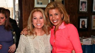 'Today' co-hosts Kathie Lee Gifford and Hoda Kotb sign in at the 13th annual Great Thanksgiving Banquet at the New York City Rescue Mission on Nov. 21, 2011, in New York City.