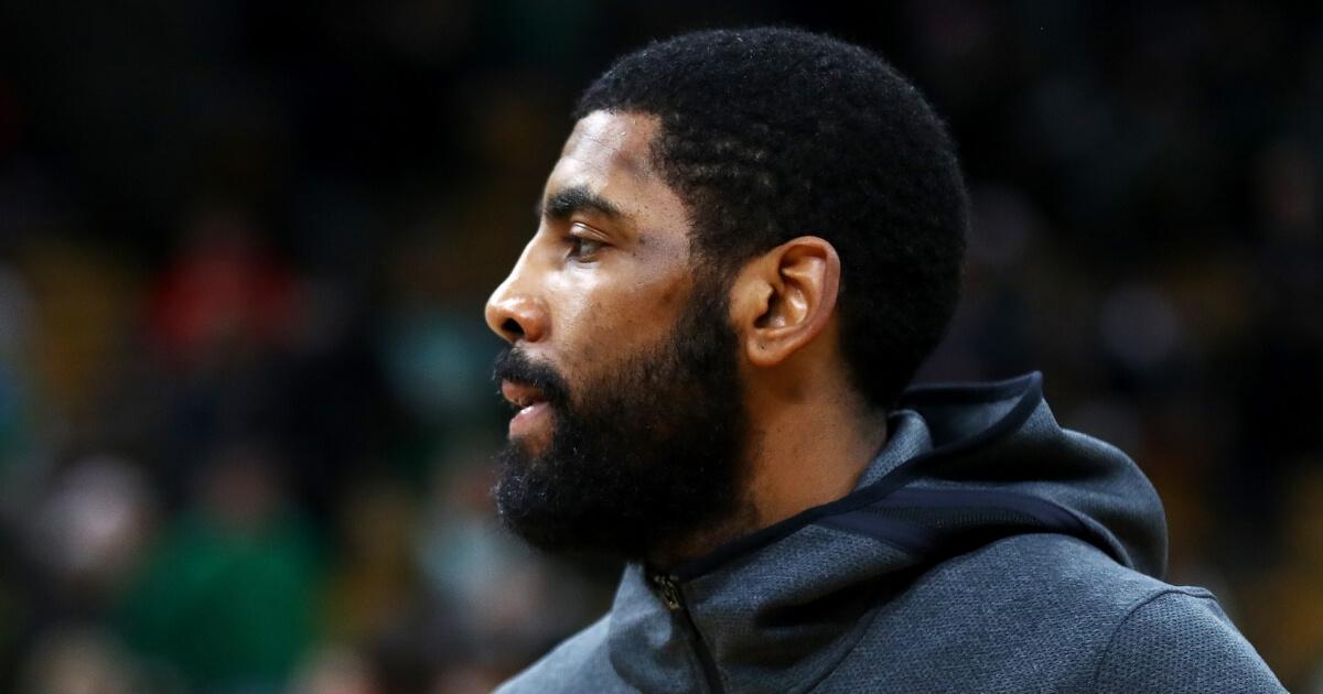 Kyrie Irving of the Boston Celtics looks on before the team's Christmas Day game against the Philadelphia 76ers at TD Garden.