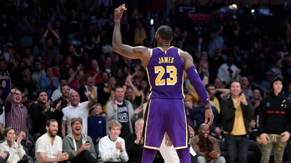 LeBron James gestures to the crowd at Staple Center in Los Angeles after scoring during the second half of Wednesday's game against the San Antonio Spurs.