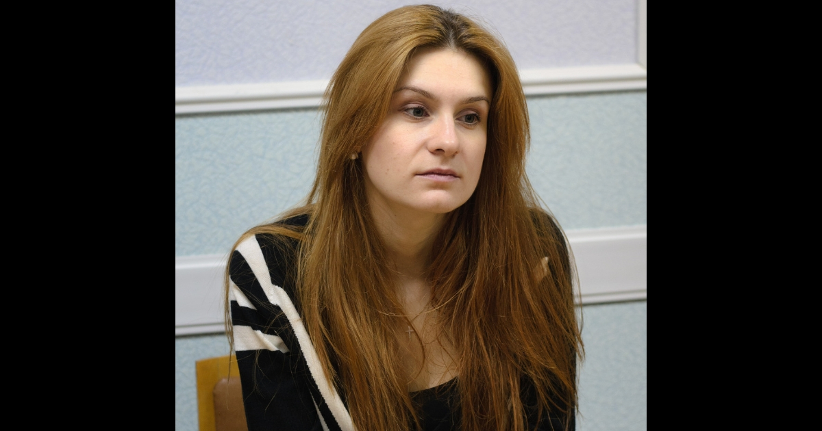 Maria Butina sits at a table.