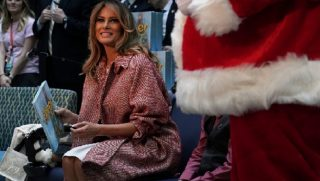First lady Melania Trump beams at the camera during a visit last week to Children's National Hospital in Washington.