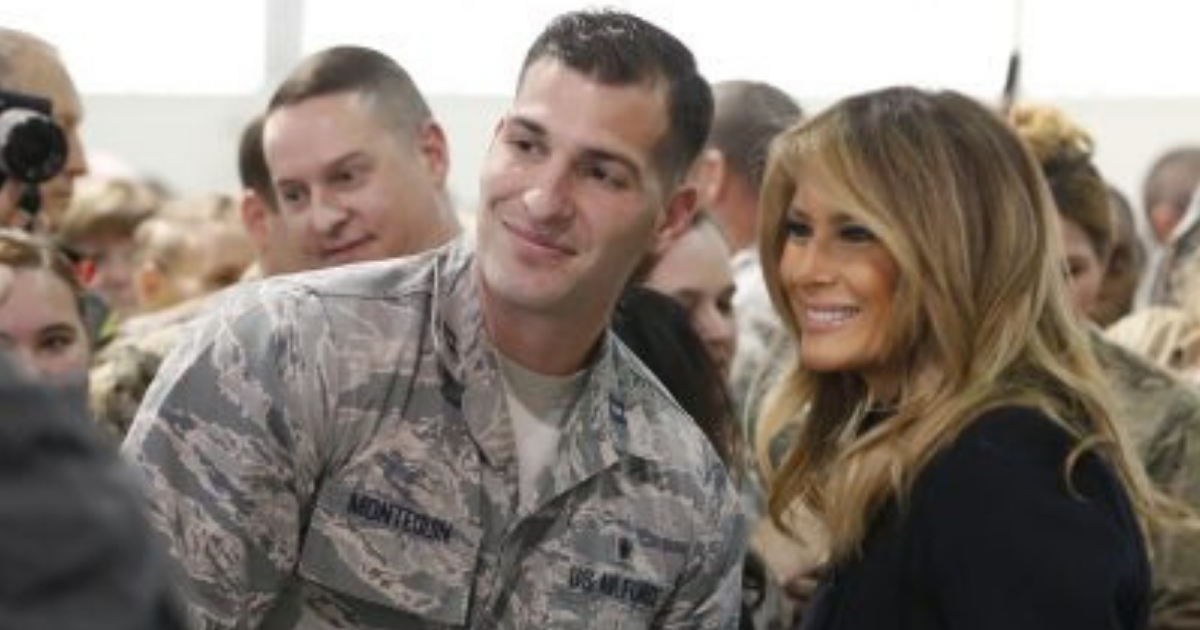 First lady Melania Trump poses with an airman during a tour of Joint Base Langley in Virginia on Wednesday.