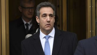 Michael Cohen leaves his sentencing hearing Wednesday in New York.