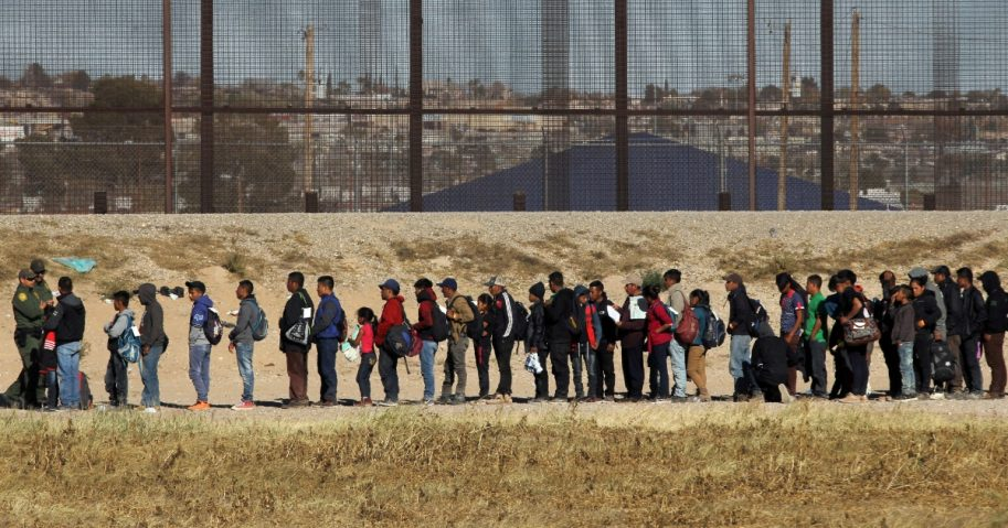 Migrants in line