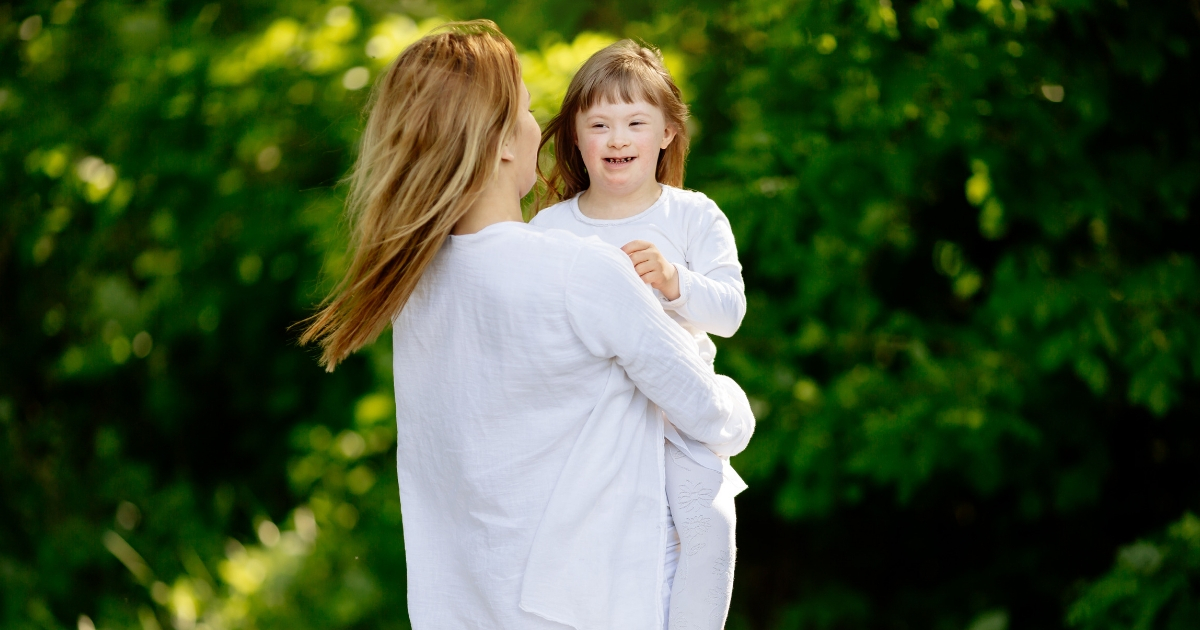 Mother with her daughter with Down syndrome.