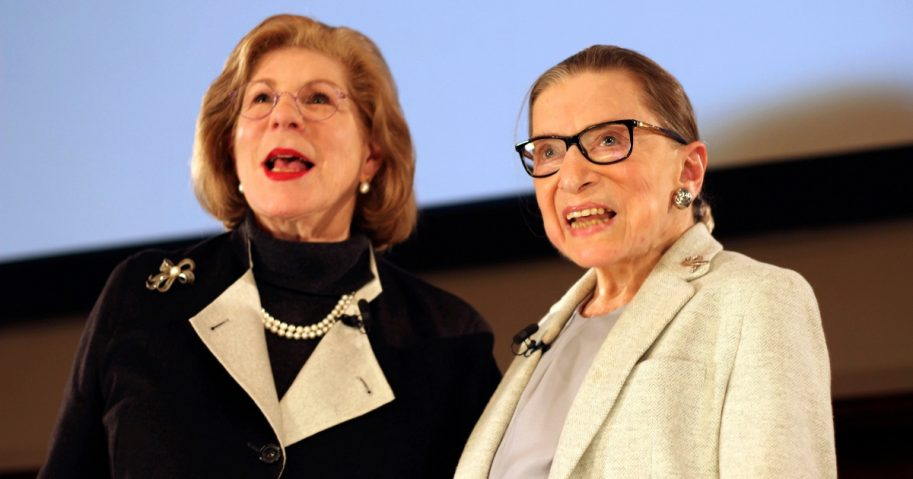 NPR's Nina Totenberg and U.S. Supreme Court Justice Ruth Bader Ginsburg stand onstage at the New York Academy of Medicine after doing a question and answer session as part of the Museum of the City of New York's David Berg Distinguished Speakers Series on Dec. 15, 2018, in New York.