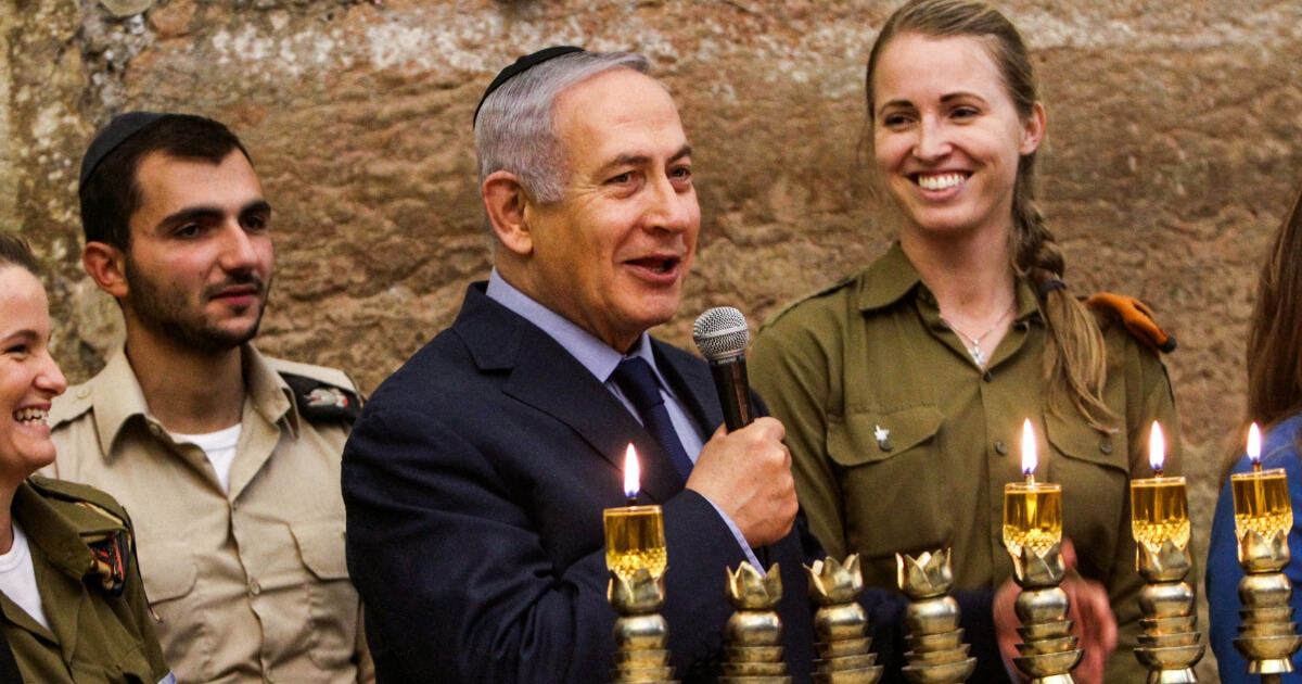 Israeli Prime Minister Benjamin Netanyahu speaks during a menorah-lighting ceremony with Israeli soldiers for Hanukkah, the Jewish festival of lights, at the Western Wall, Judaism's holiest prayer site, in the Old City of Jerusalem on Dec. 6.