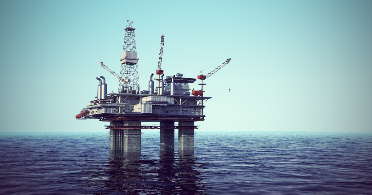 Image of oil platform on a cloudless day.