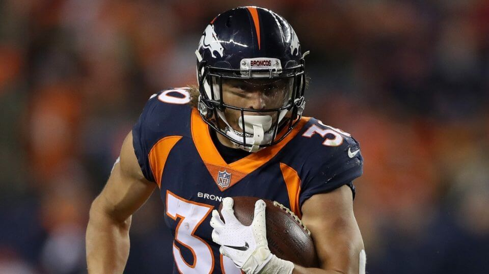 Phillip Lindsay of the Denver Broncos carries the ball against the Cleveland Browns at Broncos Stadium at Mile High on Dec. 15.