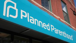 A sign hangs above a Planned Parenthood clinic on May 18, 2018, in Chicago, Illinois.