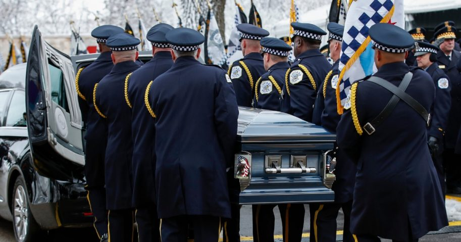 An honor guard carries the casket of slain Chicago Police Officer Samuel Jimenez to the hearse following services at the Chapel of St Joseph at Shrine of Our Lady of Guadalupe on Nov. 26 in Des Plaines, Illinois.