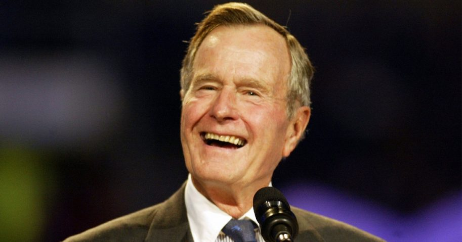 Former President George H.W. Bush speaks during the Billy Graham Crusade at Texas Stadium in 2002.