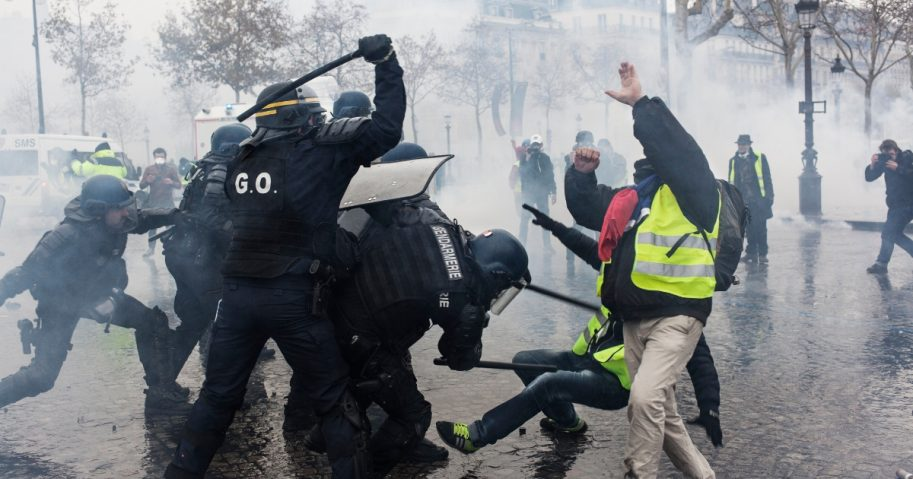 Protesters clash with riot police at the Place de l'Etoile