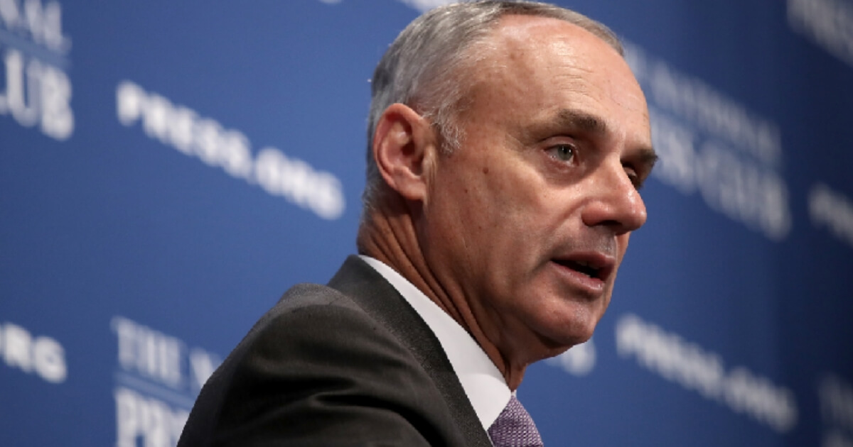 Major League Baseball Commissioner Rob Manfred speaks at the National Press Club July 16, 2018 in Washington, DC.