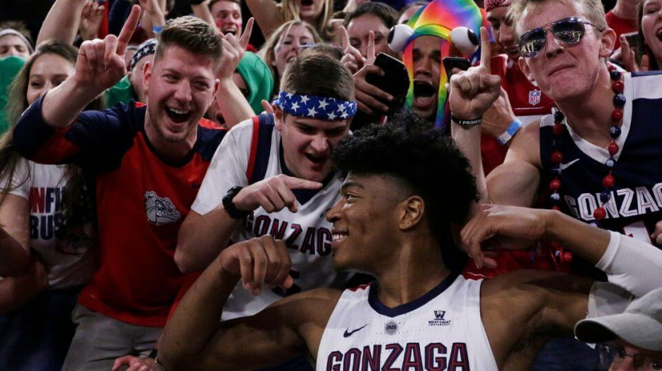 Gonzaga forward Rui Hachimura celebrates with fans after his team defeated Washington 81-79 on Wednesday.