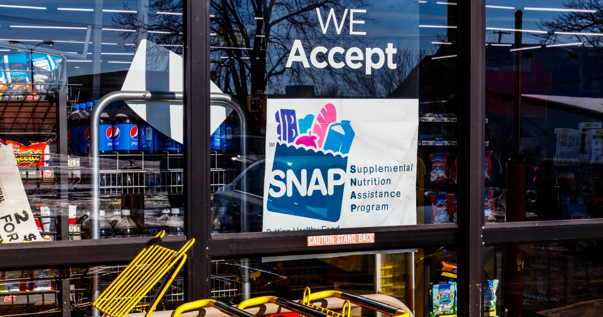 A sign advertises that a food store accepts Supplemental Nutrition Assistance Program benefits.