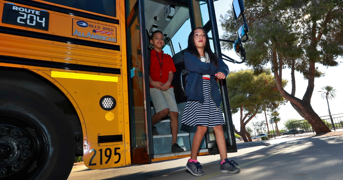 Students step off the school bus as they arrive for classes at San Marcos Elementary School on May 4, 2018, in Chandler, Arizona, after a statewide teachers strike ended.