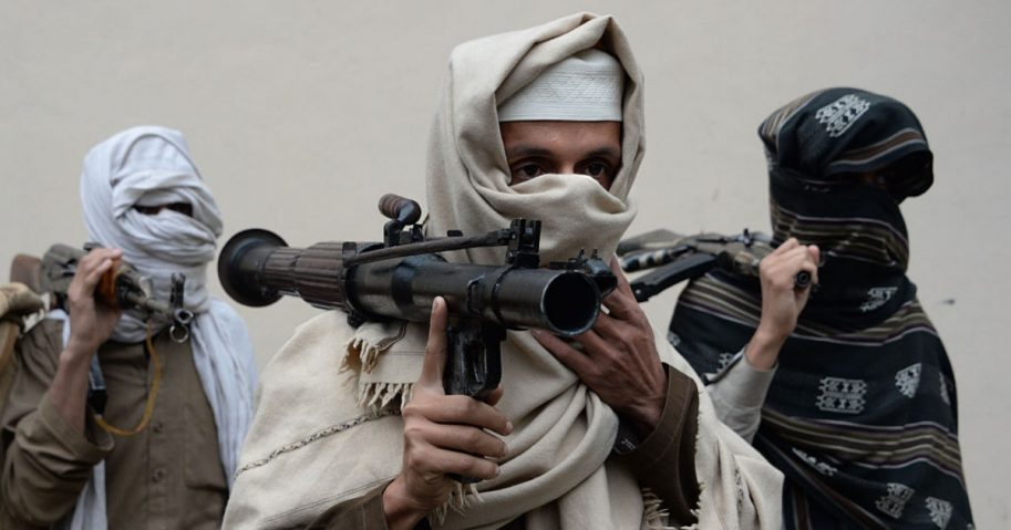Taliban fighters pictured with weapons