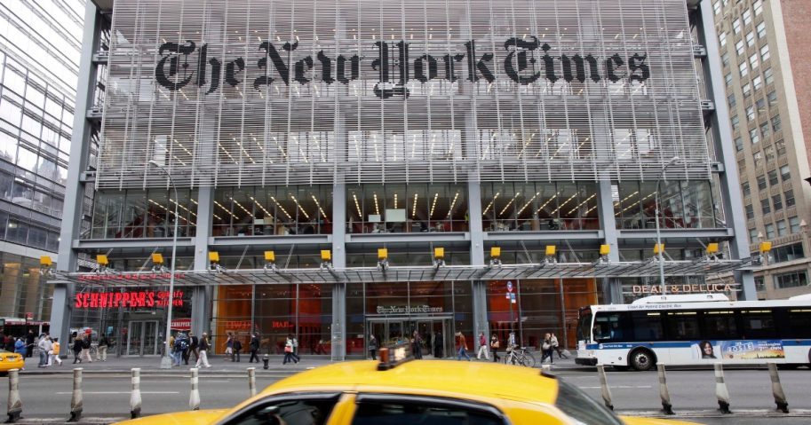 In this Oct. 18, 2011, photo, traffic passes the New York Times building, in New York.