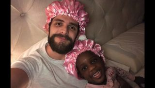 Thomas Rhett with his adopted daughter